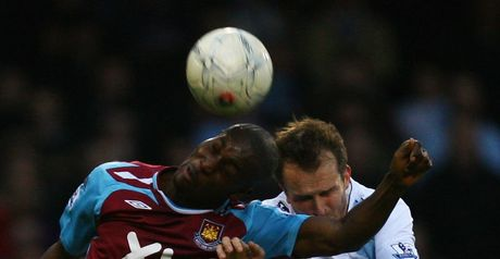 Heads I win: Carlton Cole beats Dietmar Hamann in the air.