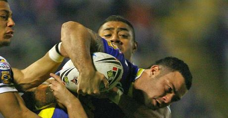 Warrington's Chris Bridge is tackled during the victory over Hull FC