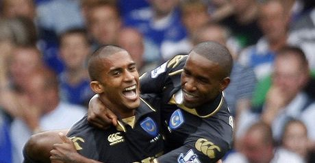 Traore and Defoe celebrate the opening goal