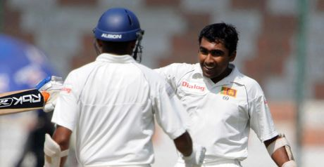 Jayawardene (right) is congratulated by Samaraweera on reaching his double century