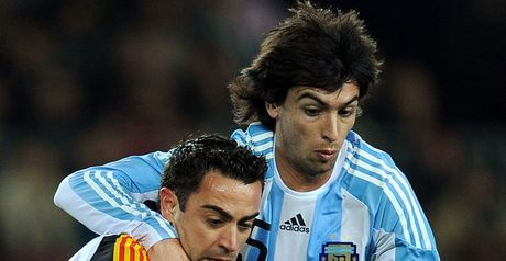 Exciting encounter: Xavi and Javier Pastore tussle for the ball