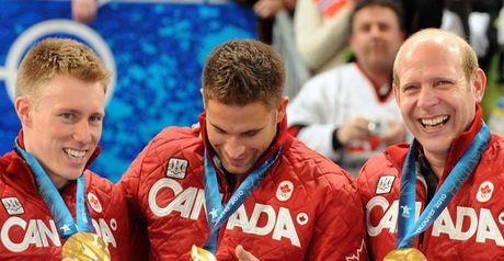 Martin (R) celebrates his gold