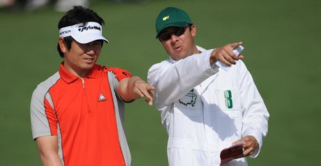 Yang and his caddie discuss a shot at Augusta