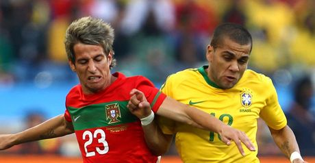 Stalemate: Fabio Coentrao and Dani Alves tussle for the ball