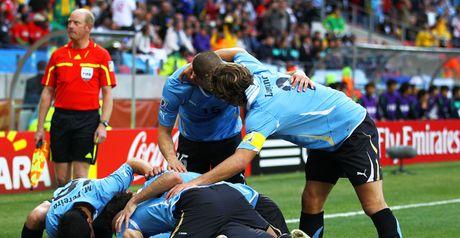 Uruguay celebrate Suarez's opener