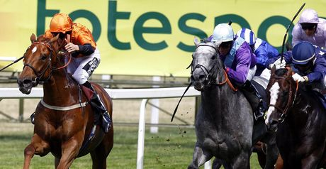 Premio Loco (left) wins the Summer Mile.