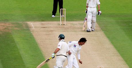 Elbow room: Ponting and Aamer have an unscheduled coming together