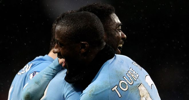 Kolo and Yaya Toure: Manchester City are hoping the Ivory Coast can face Manchester United in the FA Cup