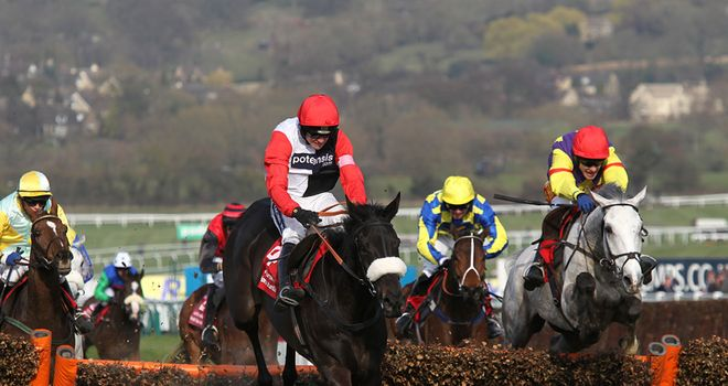 Big Buck's outpoints Grands Crus in a thriller to complete a World Hurdle hat-trick