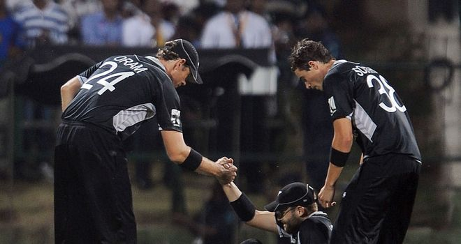 Knee injury: Vettori is helped to his feet but soon left the field