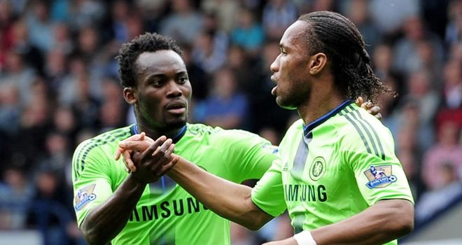 Equaliser: Drogba celebrates his close-range finish with Essien after a Shorey mistake
