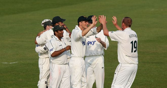 High fives: Notts scripted an unlikely victory on day three in Leeds