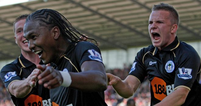 Rodallega: Is congratulated by team-mates...