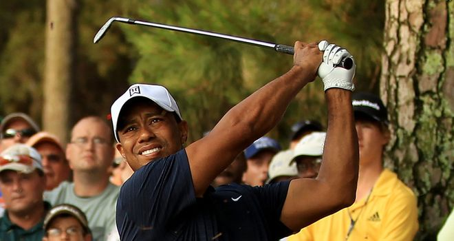Woods: Withdrew after playing just nine holes of Players Championship