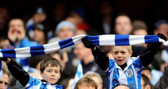 Huddersfield: Lose midfielder Chris Atkinson