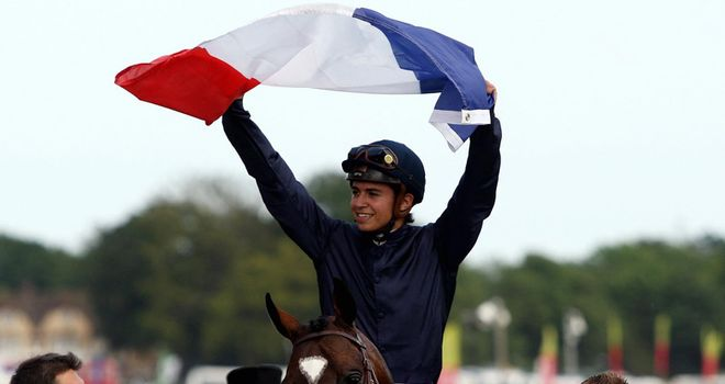 Barzalona holds the French flag in celebration at Epsom