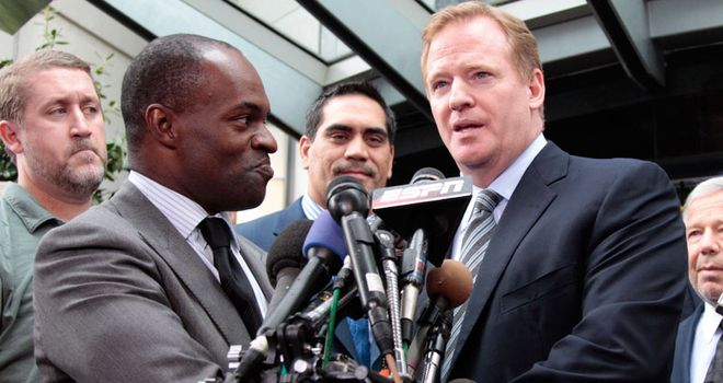 Happy ending: DeMaurice Smith and Roger Goodell reach an agreement... at last