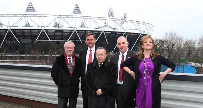 West Ham owner David Sullivan (centre) says his club could charge more next season