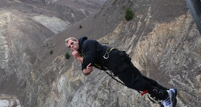 England jumper: James Haskell strikes a pose at the 134m-high Nevis Bungy jump