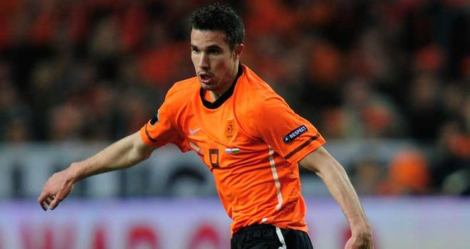 Robin van Persie: Picked up a knock in training but should be ready to face England