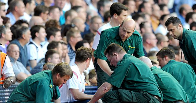 Sagna: Stretchered off after a nasty fall in a challenge with Assou-Ekotto