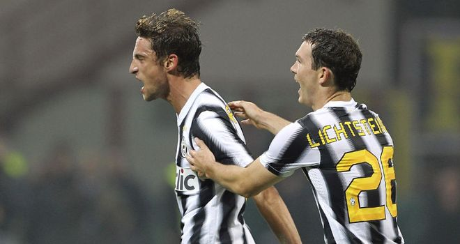 Goal joy: Claudio Marchisio celebrates his winner as Juventus beat Inter Milan to go back to the top of Serie A