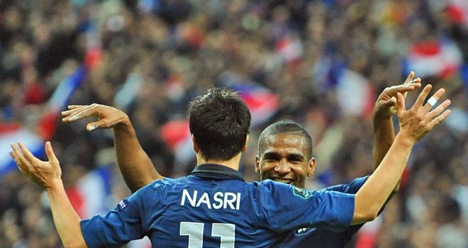 Samir Nasri puts club rivalry to one side as he celebrates with Florent Malouda in France's win