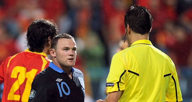 Wayne Rooney: Receives his marching orders from referee Wolfgang Stark in Montenegro