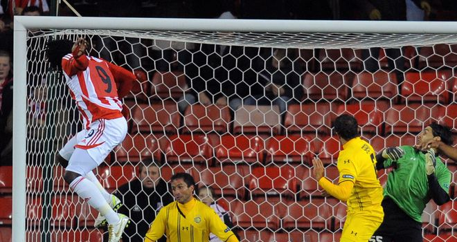 Kenwyne Jones: Stoke striker showing his dominance in the air against Maccabi