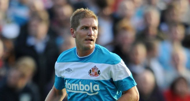 Michael Turner: Sunderland defender is undergoing a medical at Norwich City