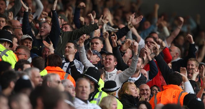Derby delight: West Brom fans celebrate victory over Wolves at the Hawthorns