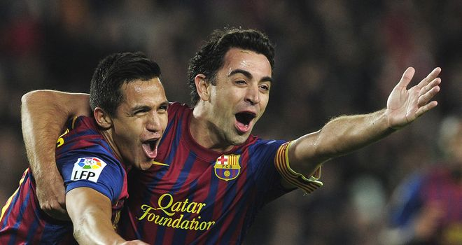 Alexis Sanchez scored a first-half double as Barcelona ran out 4-0 winners over Rayo Vallecano