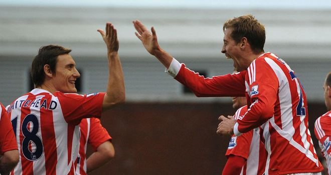 Dean Whitehead(l) has hailed Peter Crouch and is targeting a top ten finish for the Potters