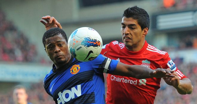 Patrice Evra and Luis Suarez: Duo set to meet again at Old Trafford on Saturday