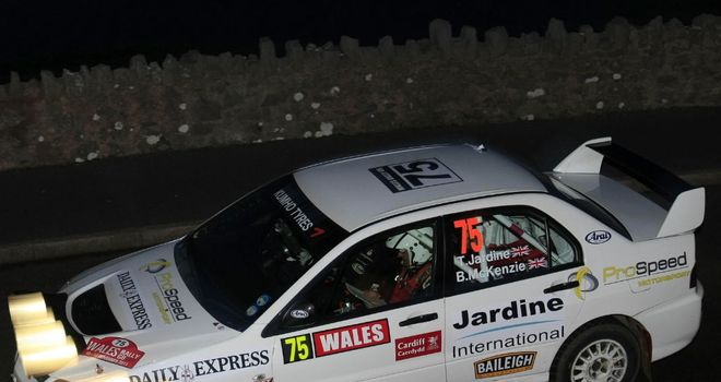 On the move: Tony Jardine and Bob McKenzie in action in their Mitsubishi Lancer Evo 9