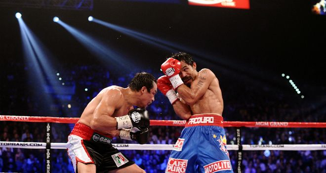 Manny Pacquiao (R): Set to fight Juan Manuel Marquez (L) for a fourth time in December