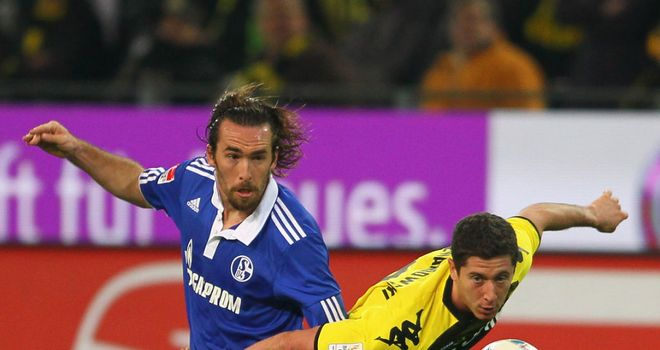 Christian Fuchs (L): Schalke full-back was watched by Manchester United scouts against Borussia Dortmund