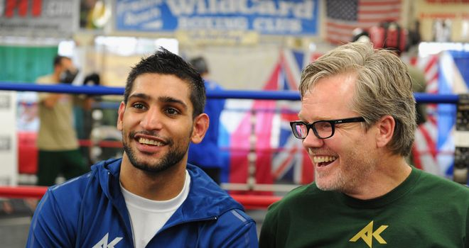 Amir Khan (L) and Freddie Roach: Have parted company