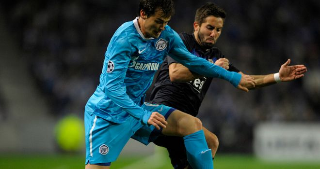 João Moutinho battles with Danko Lazovic but his Porto side could not find the goal they needed to qualify for the Champions League knock-out stages