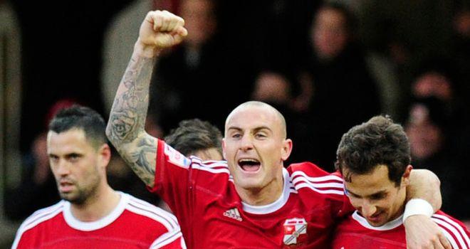 De Vita (right): Celebrates his goal with McCormack