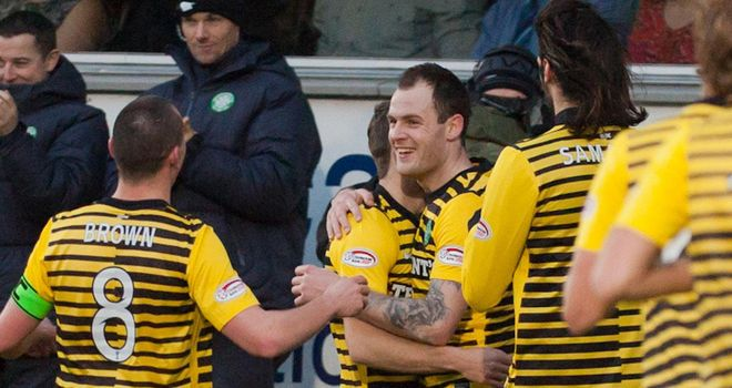 Anthony Stokes: The Celtic forward is mobbed by team-mates after hitting the opening goal away to Dunfermline