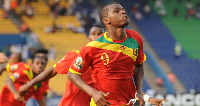 Sadio Diallo celebrates scoring for Guinea