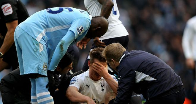 Mario Balotelli looks at Scott Parker after his apparent stamp on the midfielder