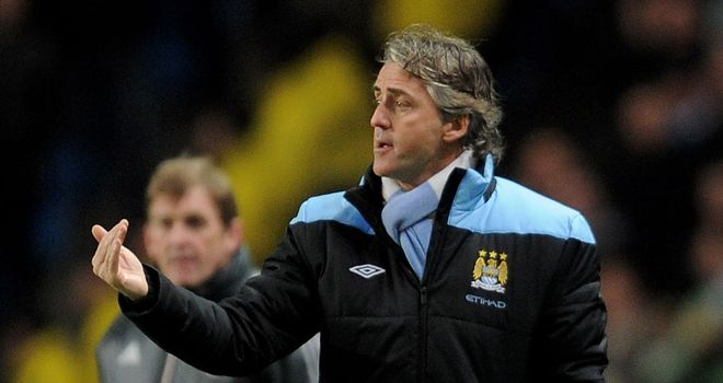 Roberto Mancini: Has played down concerns over Man City's away form