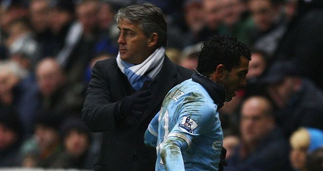Roberto Mancini: Hinted that Carlos Tevez could return to the fold if he apologises