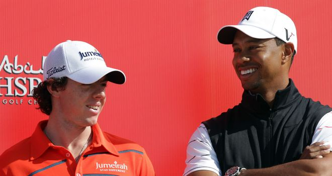 Rory McIlroy (L) and Tiger Woods (R) will play with Luke Donald for the first two rounds in Abu Dhabi