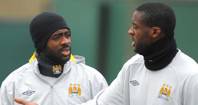 Yaya Toure: Along with brother, Kolo Toure (left), will be a big loss for Roberto Mancini