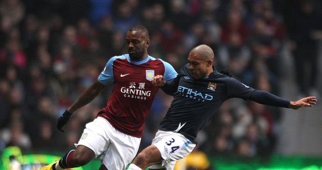 Nigel De Jong: Claims Manchester City are not feeling the pressure from Manchester United