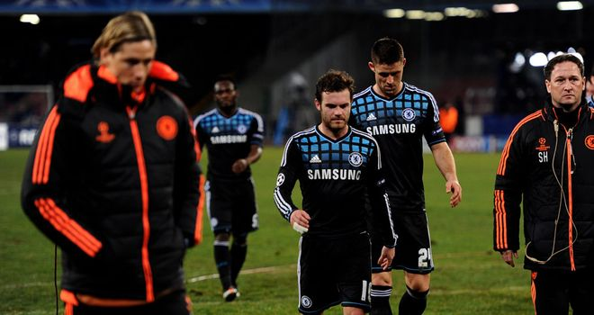 Beaten and bowed: Torres, Essien, Mata and Cahill depart the Stadio Sao Paolo
