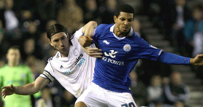 Beckford: Holds off Barker at Pride Park